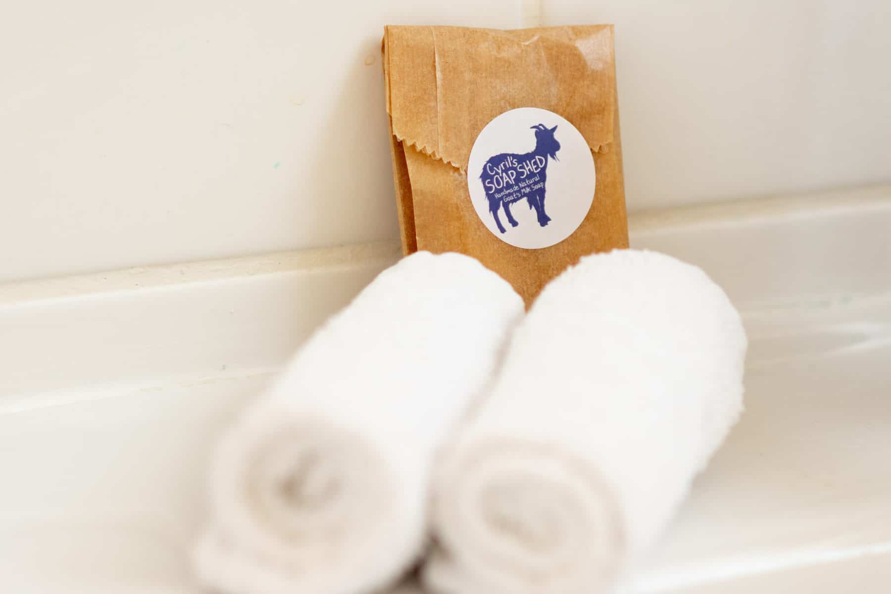 Cyrils Soap Shed-guest behind rolled towel jan large